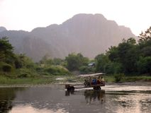 Water tractor vang vieng river laos Stock Images