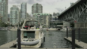 Water Traffic with Seabuses Taxis and Buildings along Burrard Inlet in Granville Island Vancouver BC Canada stock video