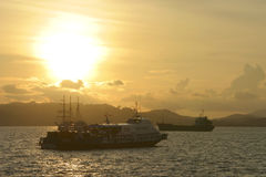 Water Traffic at Sunset. Passenger ferry and ships sailing near Langkawi Island, Malaysia stock images