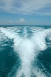 Water trail behind boat Royalty Free Stock Image