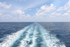 Water trail of cruise ship in open sea. Royalty Free Stock Images
