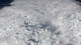 Water trail foaming behind a ferry boat in Atlantic ocean stock video footage