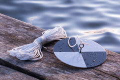 Water transpacency measurement disk with rope on a wooden dock. Secchi disk with rope on a wooden dock, prepared for water transparency measurement Royalty Free Stock Image