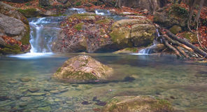 Water transparency. Little waterfall in Crimea mountains in autumn Stock Images