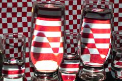 The water in the transparent glasses on the background royalty free stock photos