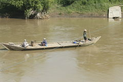 Water transportation. Bengawan Solo water transport, canoe crossing with tail and manually Stock Images