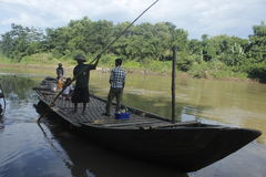 Water transportation. Bengawan Solo water transport, canoe crossing with tail and manually Stock Photography