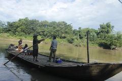 Water transportation. Bengawan Solo water transport, canoe crossing with tail and manually Stock Photos