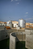 Water treatment plant. Scenic view of water treatment plant with blue sky background Stock Photo