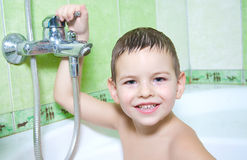 Water treatments. The boy in the bathroom, with an excellent mood, the completion of water treatments Royalty Free Stock Photography