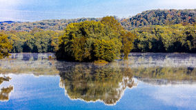 Water and trees reflect in Virginia River, October 26, 2016 Stock Photo