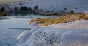 Water in Cotton Castle in Pamukkale Turkey. Water trickles down the travertines of the Cotton Castle in Pamukkale Turkey stock video