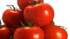Water trickles off stack of red tomatoes. Rotating in frame stock video footage