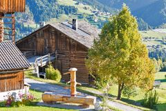 Water trough for farm animals in Alps mountains village. A water trough for farm animals in Alps mountains village Nostra, Western Carinthia, Austria Royalty Free Stock Photography