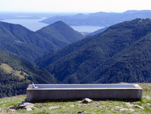 Water trough on lake and mountains background Royalty Free Stock Image