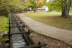 A water trough leads to an old grist mill. Royalty Free Stock Photography