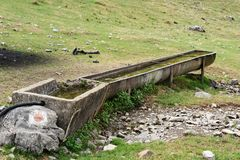 Water trough in the in the mountains Royalty Free Stock Photography
