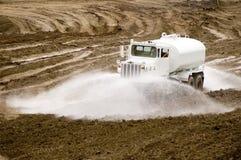 Water Truck. Construction site water truck watering down development area Stock Photo