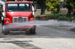 Water truck. A water truck spraying the road Royalty Free Stock Photo