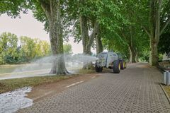 Water truck in action during drought watering old trees royalty free stock images