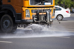Water truck cleaning street Royalty Free Stock Image
