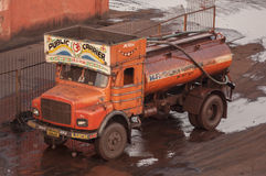 Water truck in a grimy coal port Stock Photo
