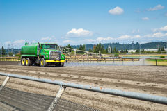 Water truck on horse race track Stock Photo