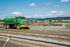 Water truck on horse race track Stock Images