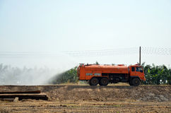 Water Truck Spray To Ground For Protect Occur Dust Stock Photo