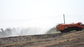 Water Truck spray to ground for protect occur dust stock video footage