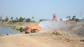 Water Truck spray to ground for protect occur dust stock footage