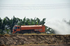 Water Truck spray to ground for protect occur dust Stock Image