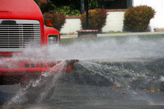 Water truck spraying road Royalty Free Stock Images