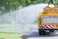 Water truck watering in the garden Royalty Free Stock Photo