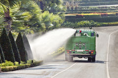 Water truck watering plant in park Stock Images