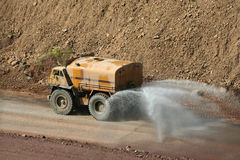 Water truck working at a rock quarry Royalty Free Stock Images
