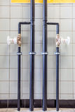 Water tubes on the wall Stock Photography