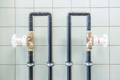 Water tubes on the wall Royalty Free Stock Photos