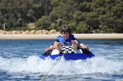 River water tubing skiing teen boy Stock Images
