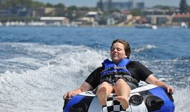 River water tubing skiing teen boy Royalty Free Stock Image