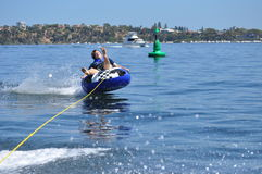 Water tubing skiing teen boy Royalty Free Stock Photography