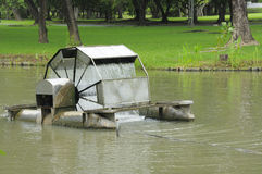 Water turbine floating on the lake of park Stock Photography