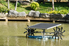 Water turbine with solar panel for water treatment increasing ox Royalty Free Stock Photography