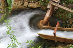 Water turning waterwheel  Royalty Free Stock Photos
