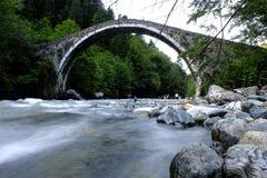 Water under an arch stone bridge royalty free stock photos