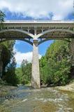 Water under the bridge. Image of the historic David Street bridge in Elora Ontario over the Irvine River stock photos