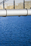 Water under a bridge. Close up of a bridge with blue clear underneath it royalty free stock photo