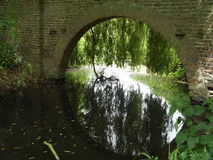Water Under The Bridge. A Arched Brick Bridge Over A River stock photos