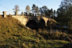 Water under the bridge. Beautiful stone bridge crossing a river royalty free stock photos