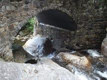 Water under bridge. Covered bridge water stock photos